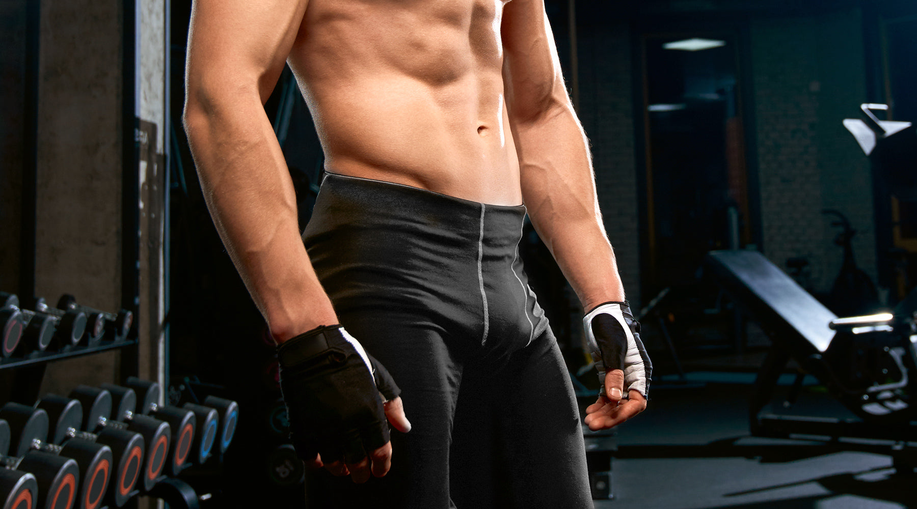 Man's bare midsection with black tights that has a lot of pelvic muscle strength