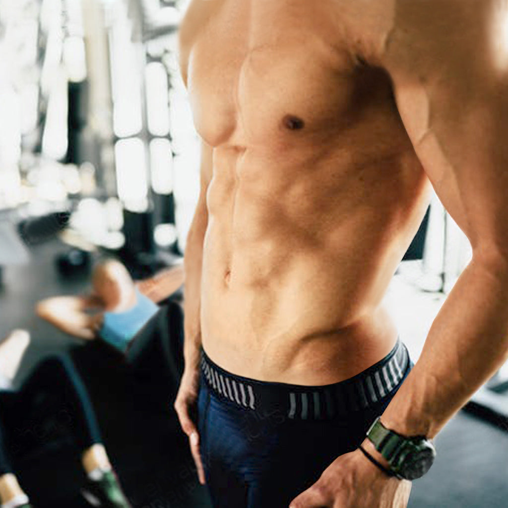 Shirtless midsection of very fit man at gym