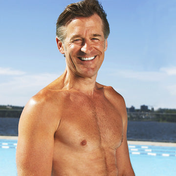 Healthy looking late middle age man in front of pool