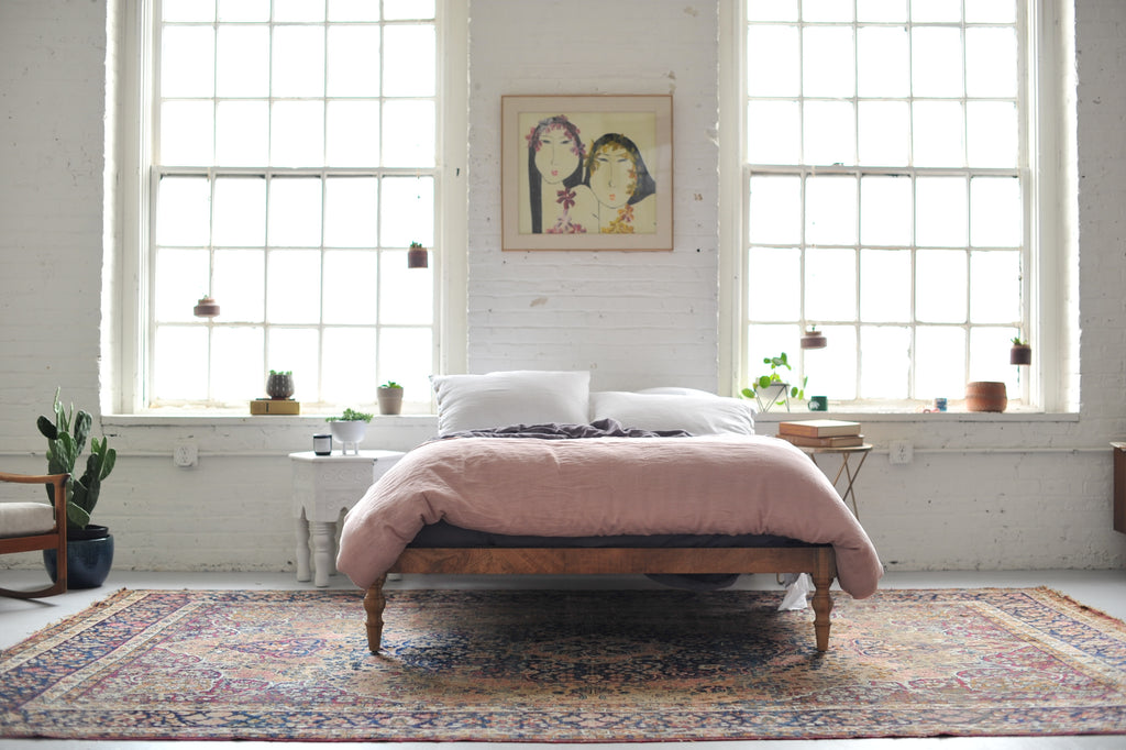 Antique Persian Rug in New York style loft bedroom
