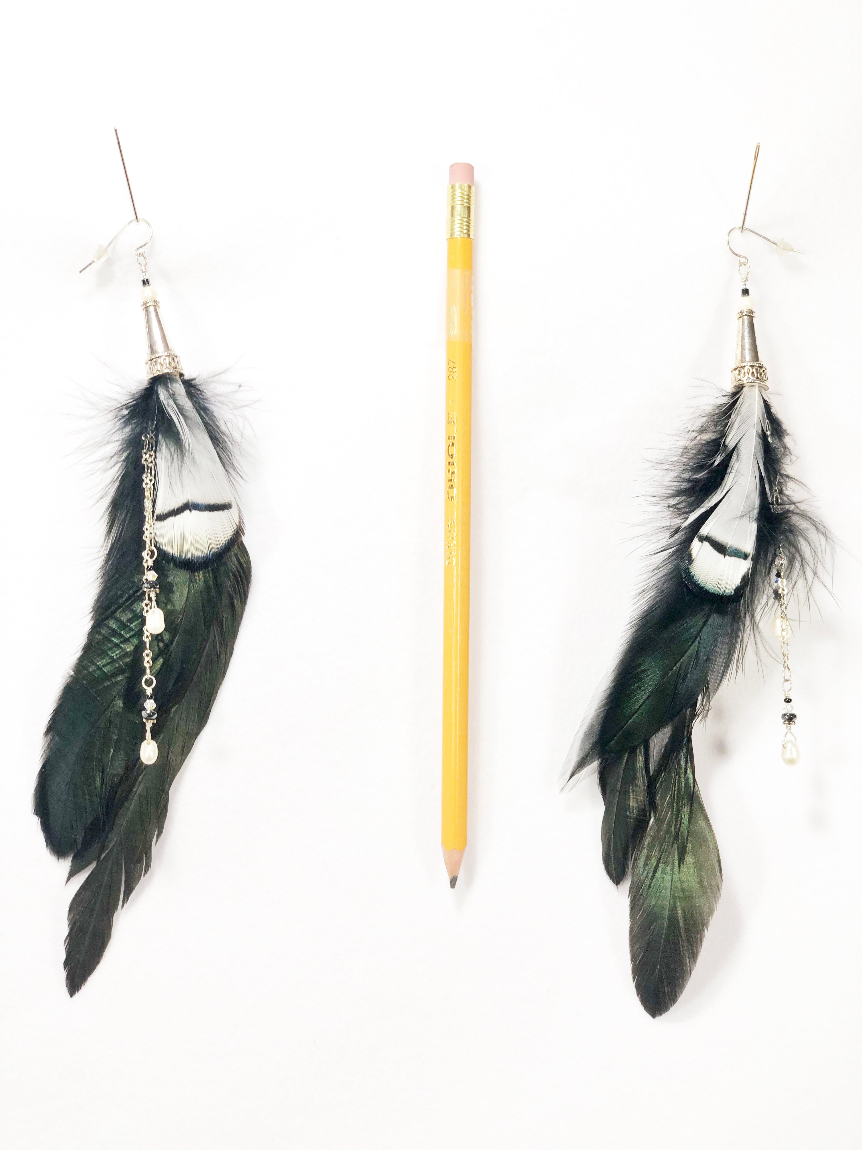 ER05 Pair of feather earrings with black and white feathers, pearls, and silver accents.