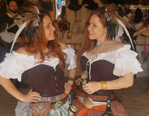 Matched pair of beautiful Fey sweep barrettes being shared by two Ren Fest friends, create a sort of mirror image.
