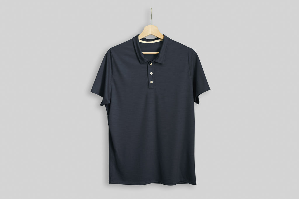 Charcoal Signature Merino Golf Polo Shirt displayed on a hanger