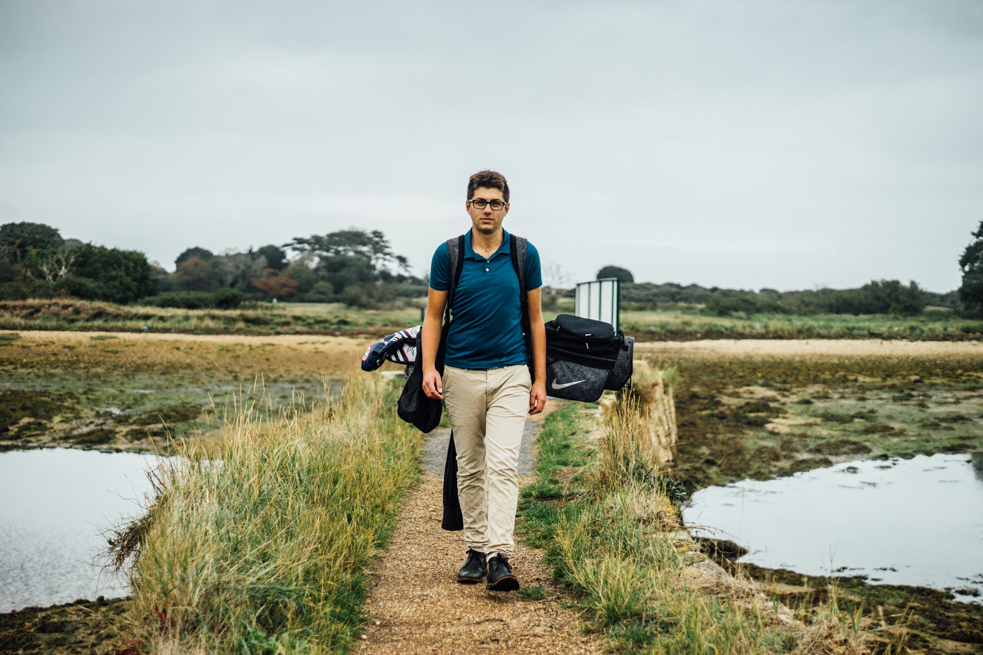Golfer wearing the Signature Merino Golf Polo Shirt on the former linksland site of the Royal Isle of Wight Golf Club