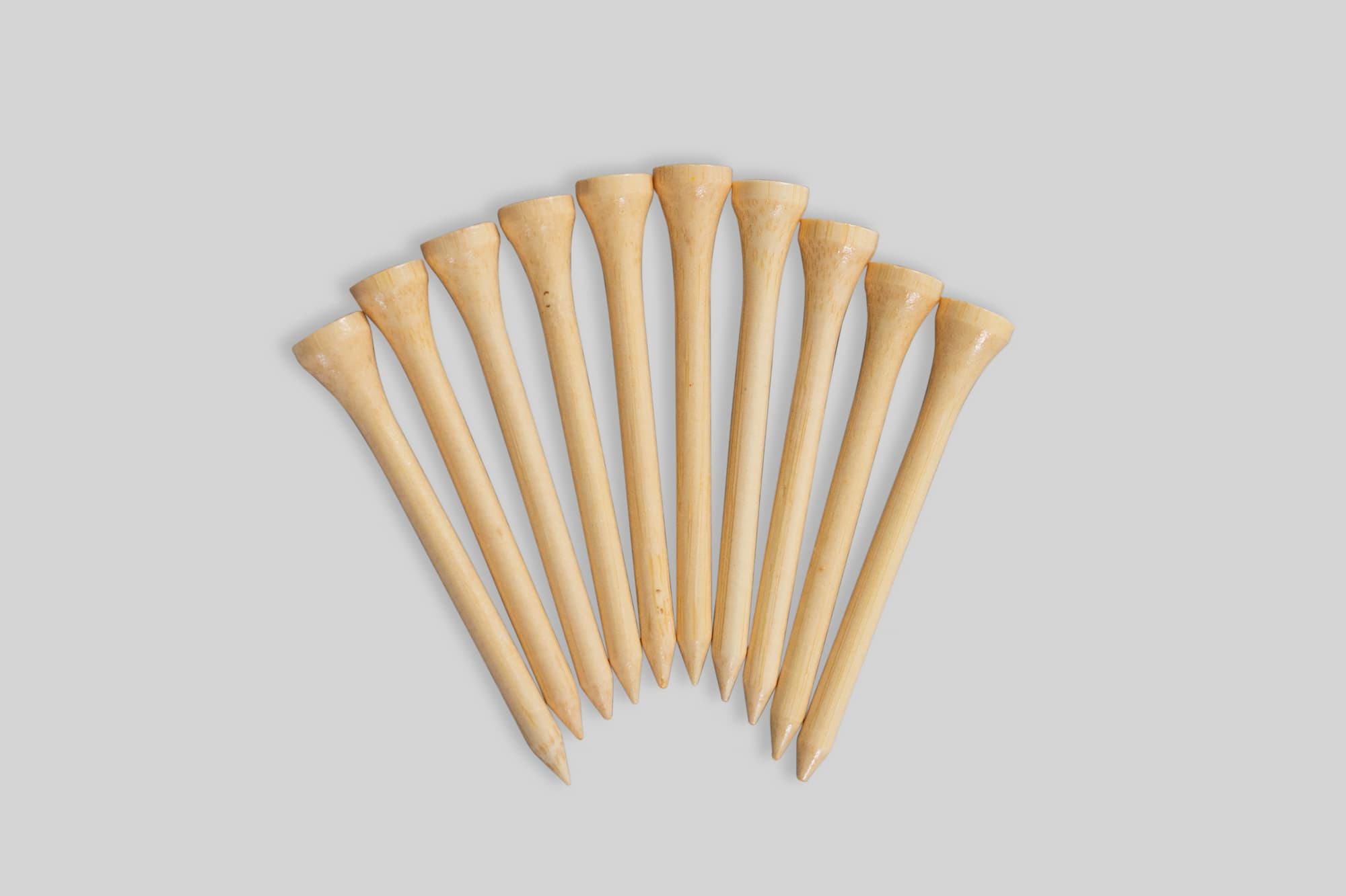 Bamboo Golf Tees in an arched line