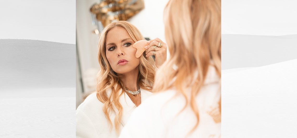 Rachel Zoe using a Skin Gym Gua Sha 2