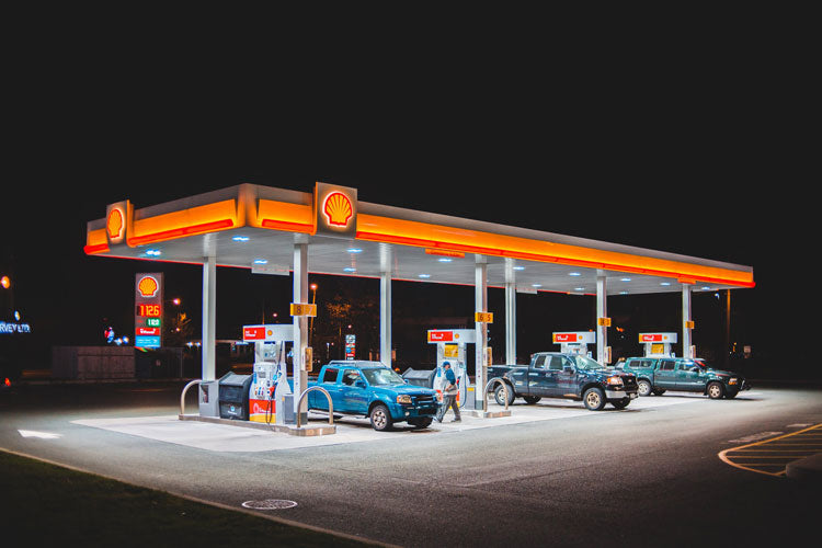 Filling cars with gasoline at a Shell gas station.