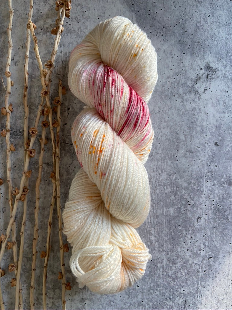 Off White Red Orange Speckled SW Merino Nylon Yarn