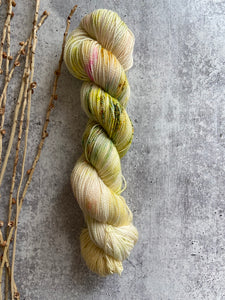 Pale Yellow Green Speckled SW BFL Nylon Fingering Weight Yarn