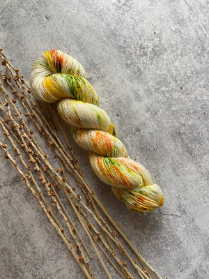 Yellow Orange Green Speckled SW BFL Nylon Fingering Weight Yarn
