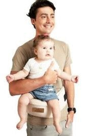 Man with baby on a hip belt