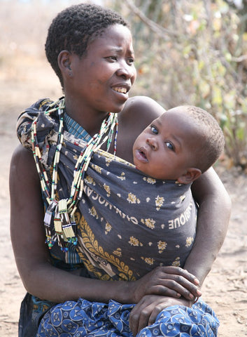 Mother with a baby in a sling