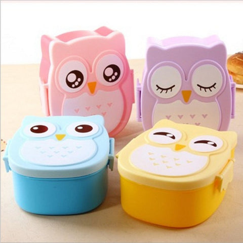 Four lunch boxes in different colours with owl features