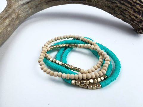 5 Strand Wood and Turquoise bracelets