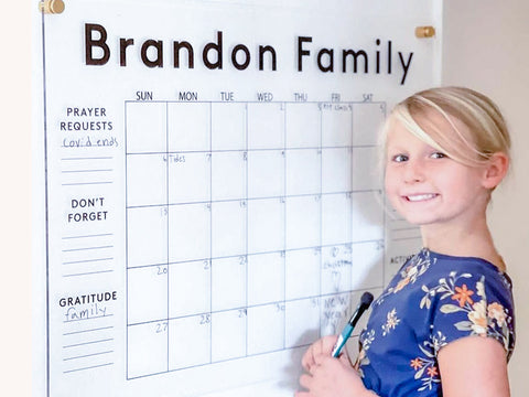 young smiling girl with Wall Snobs acrylic family planner