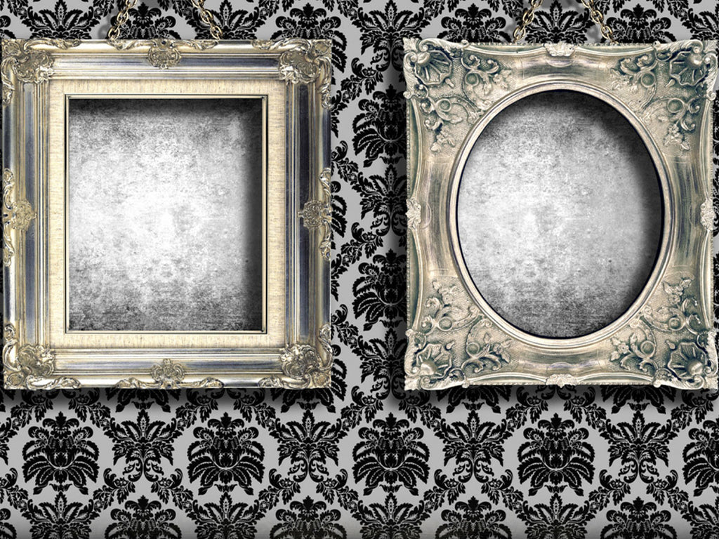 Image of black and white wallpaper with antique frames hanging