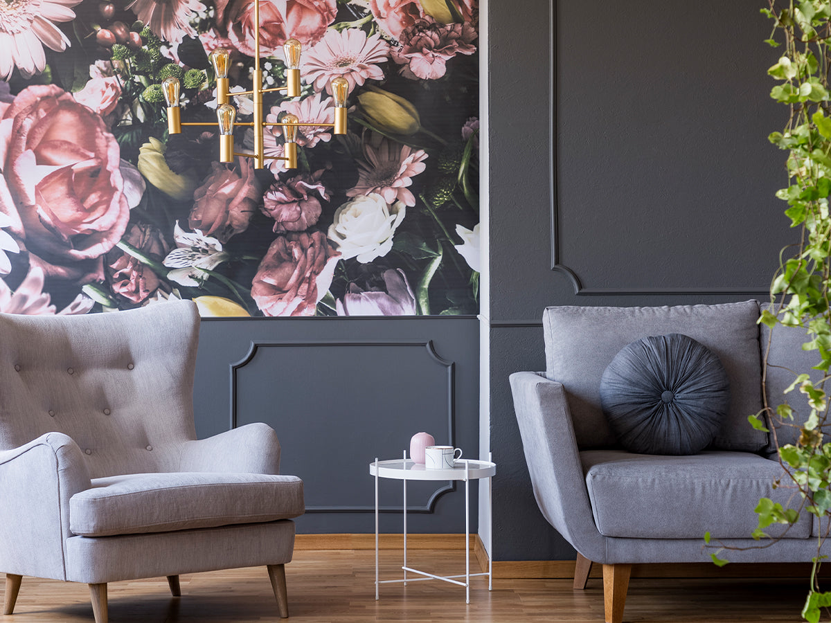 Image of a gray sitting room with a wall paper accent wall with big, bold flowers