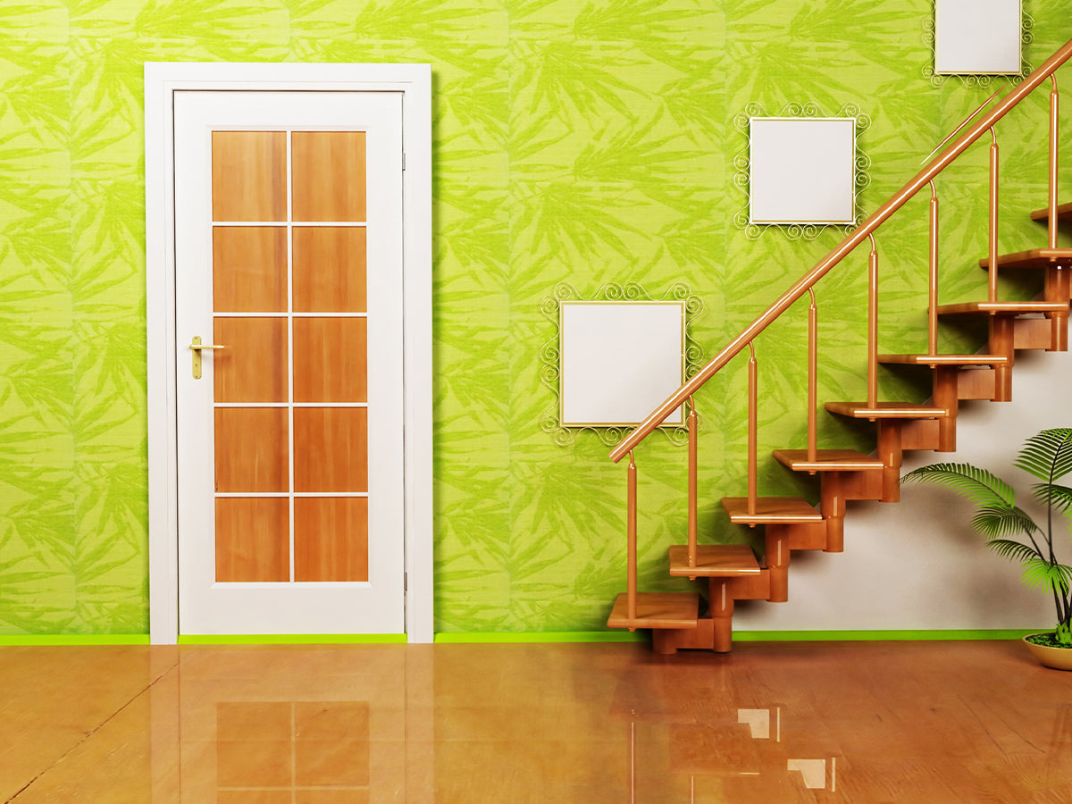 Image of a room with bright lime green wallpaper with a botanical pattern