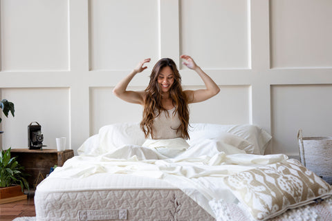 Happy woman in natural mattress