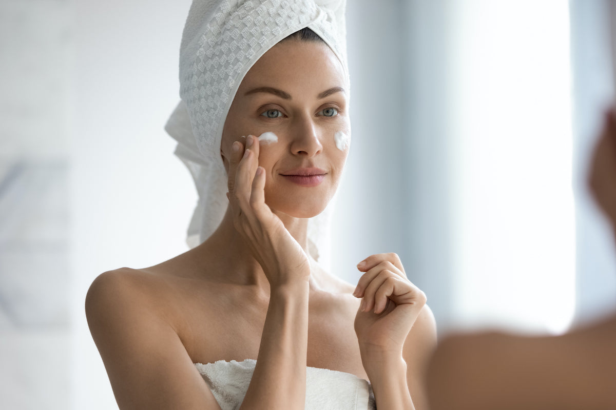 woman applying beauty products