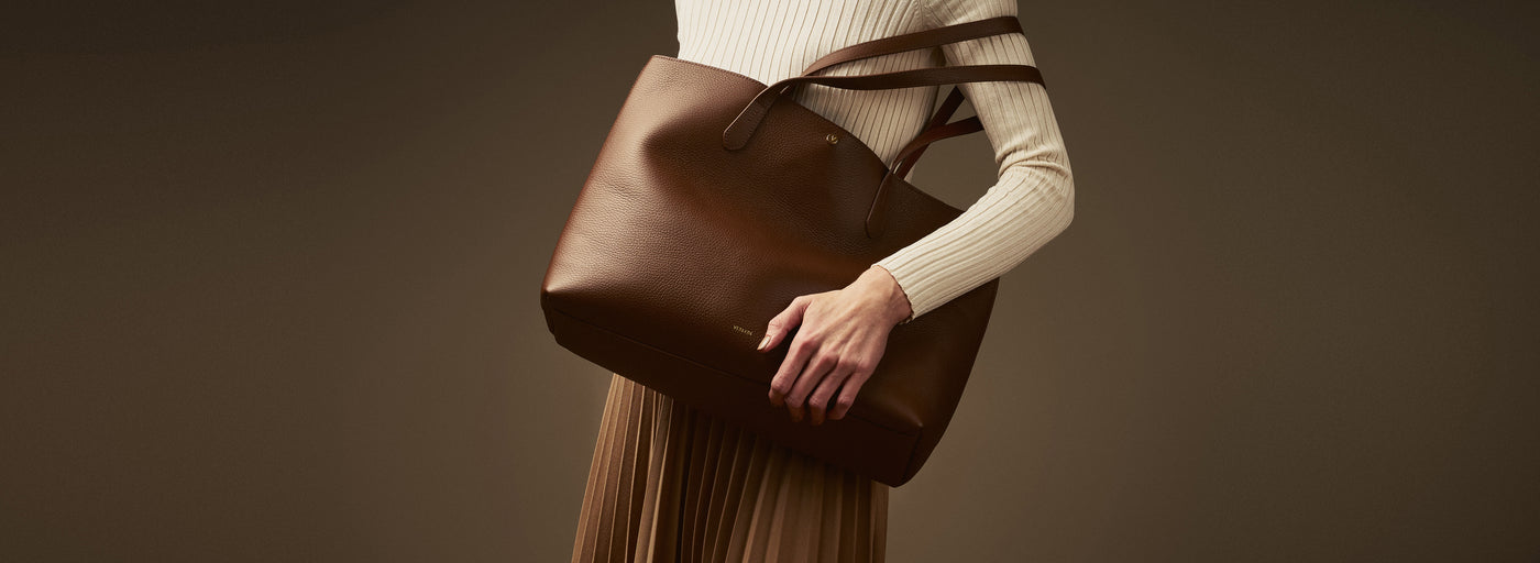 Verlein's Brown Julia Tote with yellow dress, from the SS19 Campaign