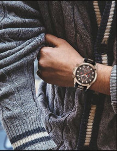man-wearing-golden-black-precision-watch