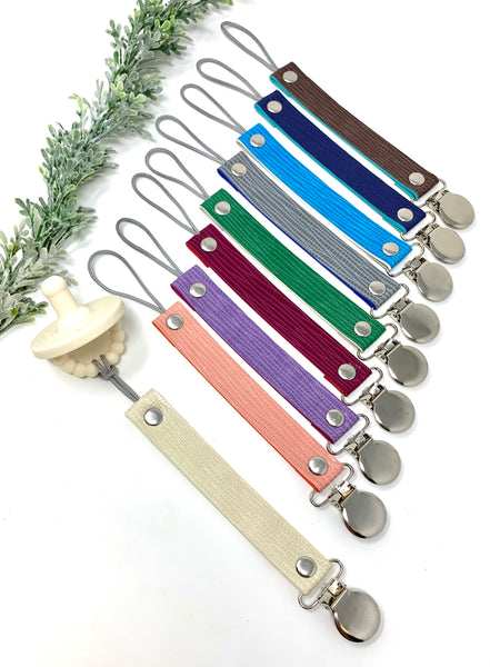 Faux leather pacifier clips
