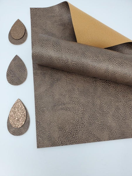 # 3 Metallic faux leather sheets.  H2068