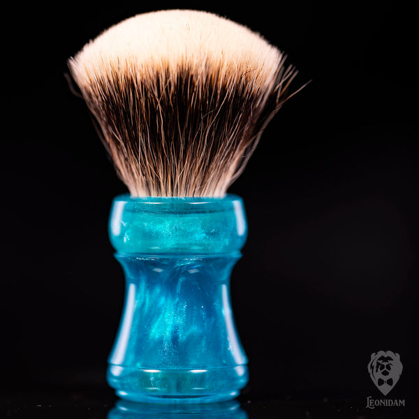 "Handmade Shaving Brush ""Adrion"" in polished light blue and silver resin."