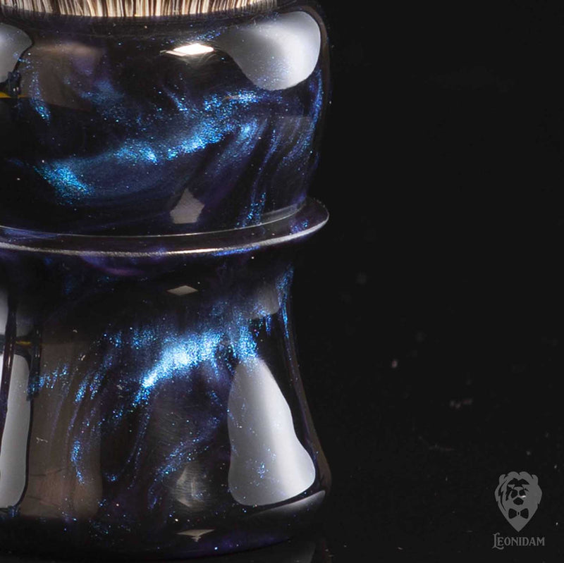 "Closeup of Handmade Shaving Brush ""Nox"" in polished black and blue resin"