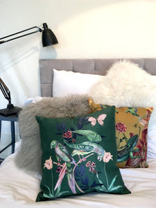 Forest green and blush pink 'Plumage' Cushion with parrot design made from Vegan Suede