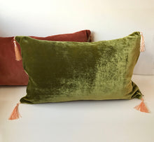 Load image into Gallery viewer, Silk Velvet Cushion 'Mellow ' in avocado green with pink tassels, rectangular shape, feather filling