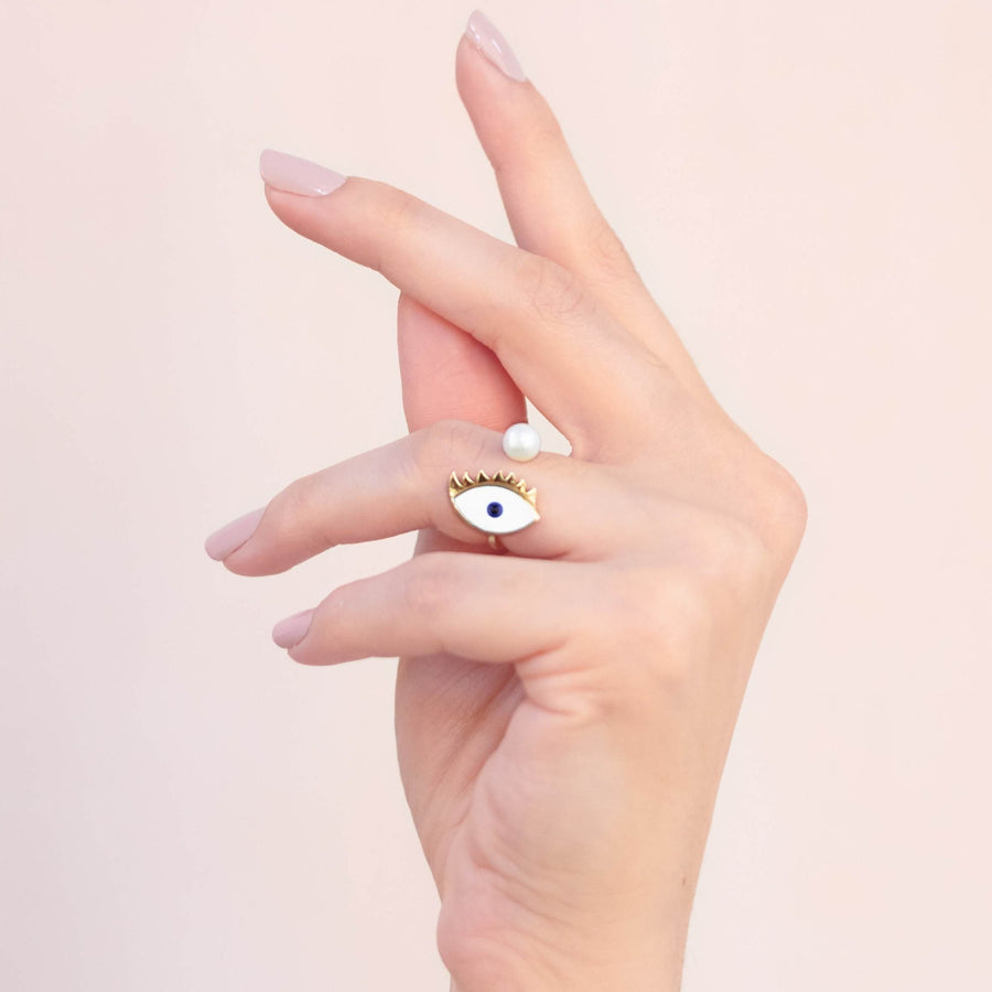 Hand painted enamel gold plated eye ring with pearl worn on finger
