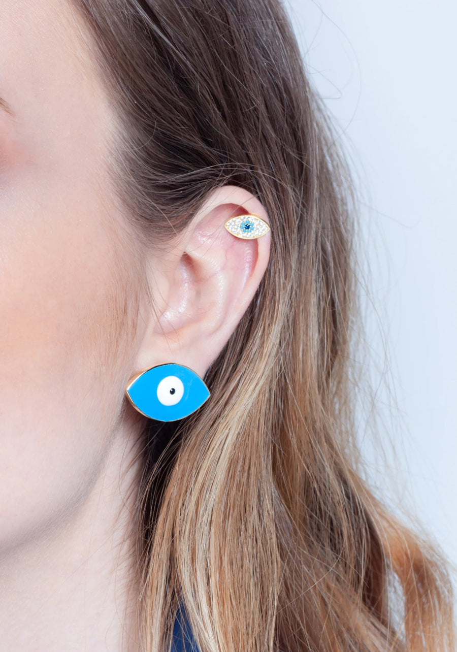 Hand painted enamel and gold plated turquoise eye stud worn on ear