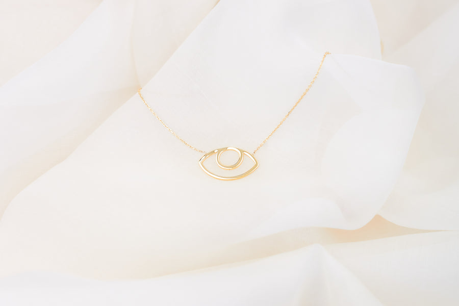 Abstract gold plated eye necklace on lace