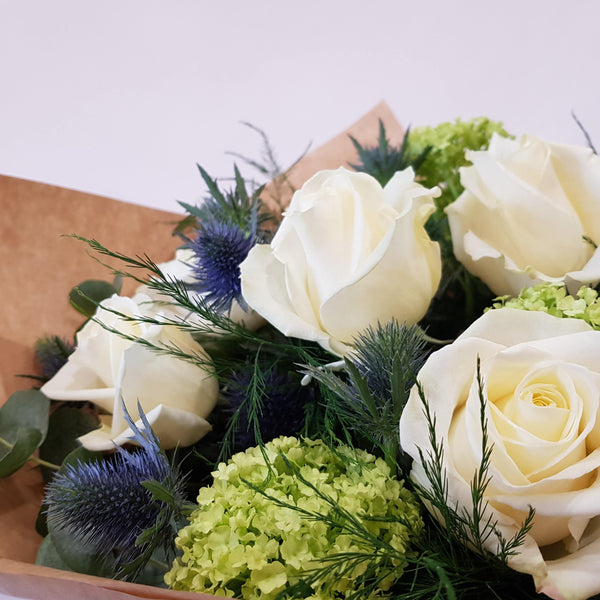 Hand-tied Bouquet.      Designer's Choice