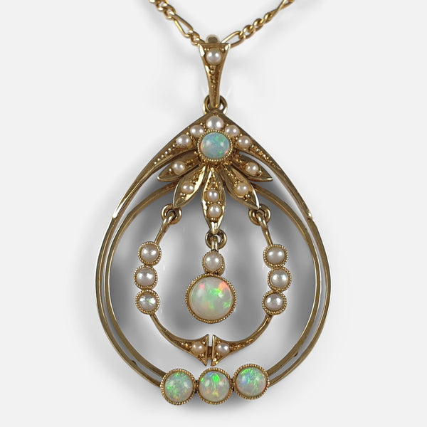 the Edwardian 15ct gold pendant set with opals and pearls viewed from the front