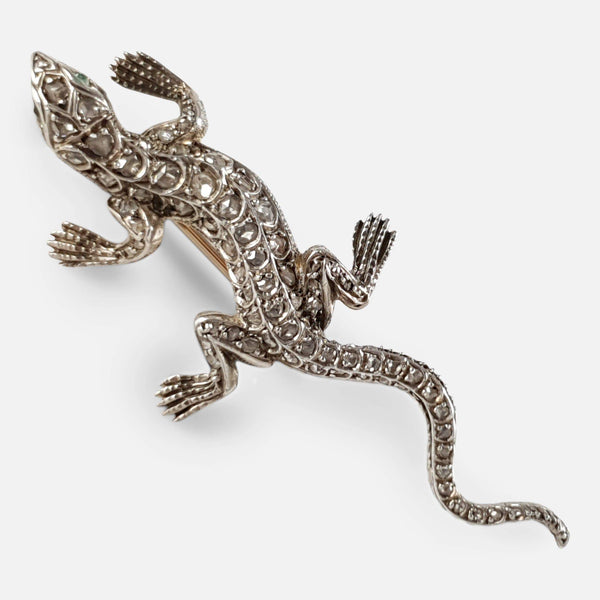 the lizard brooch at a diagonal angle