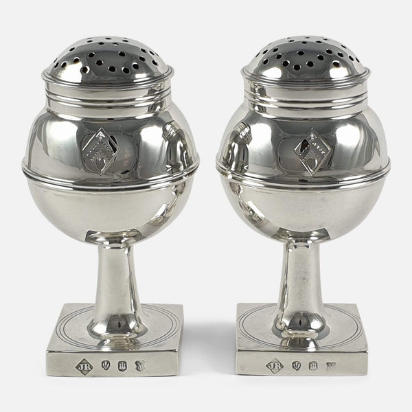 The pair of 1920s Scottish sterling silver pepper casters viewed from the front