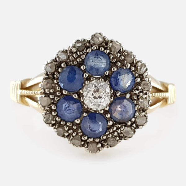 the 18ct gold diamond and sapphire cluster ring viewed from the front