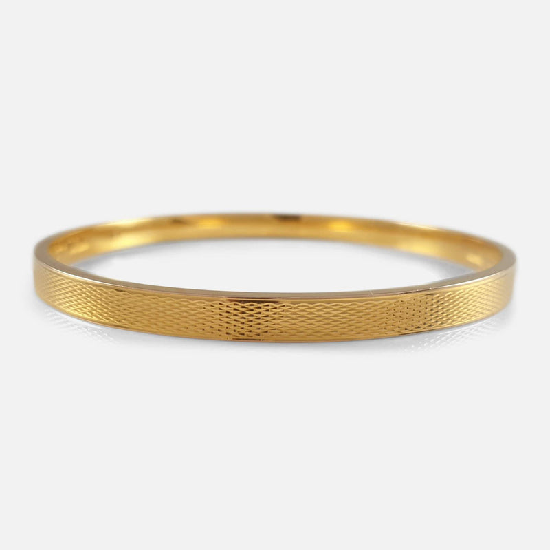 the 15ct Gold Bangle resting flat