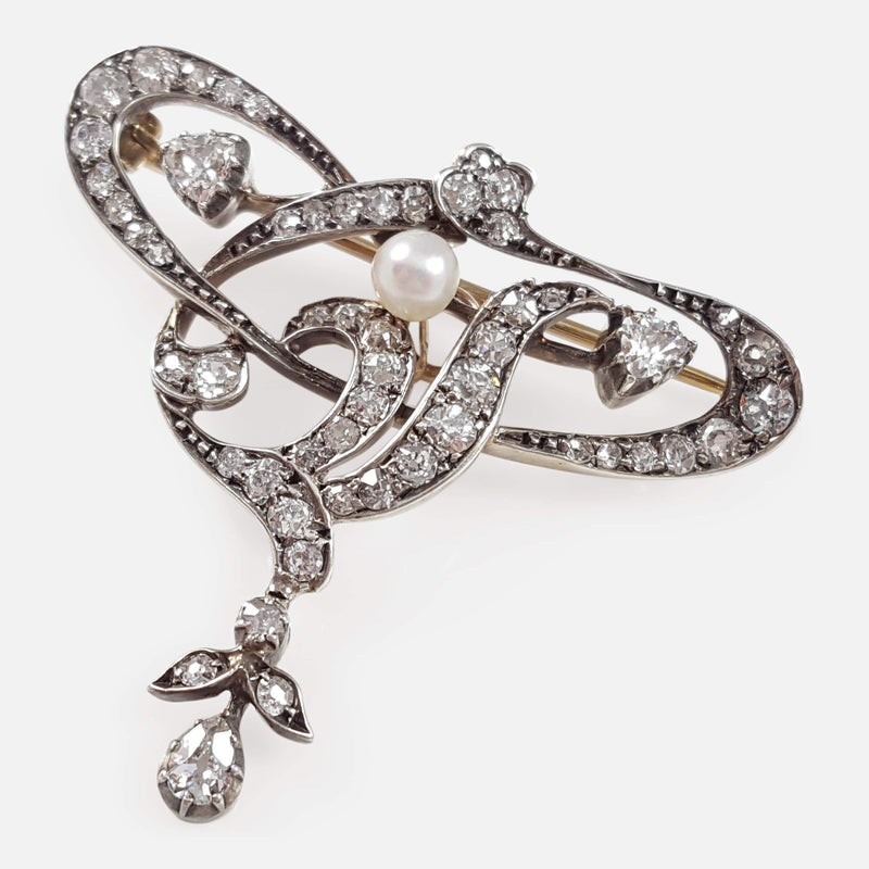 Art Nouveau Silver, Gold, Diamond, and Pearl Brooch viewed from above angled
