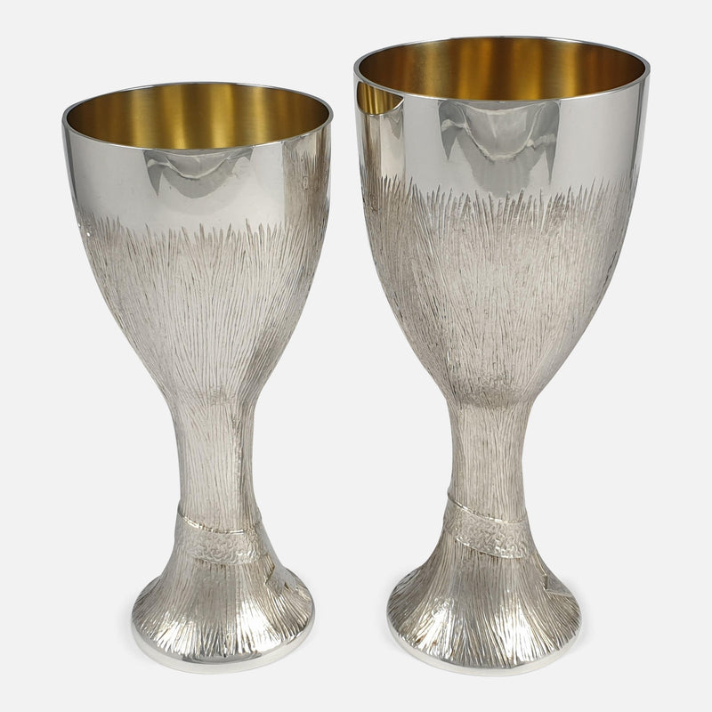 a side on view of both of the silver cups