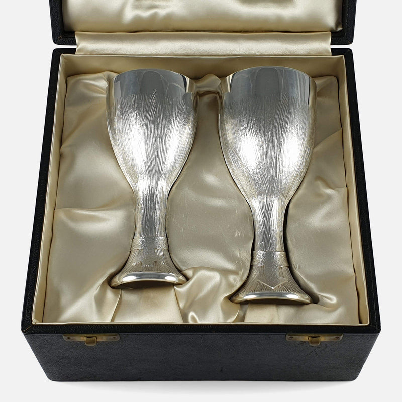 the sterling silver cups viewed in their case