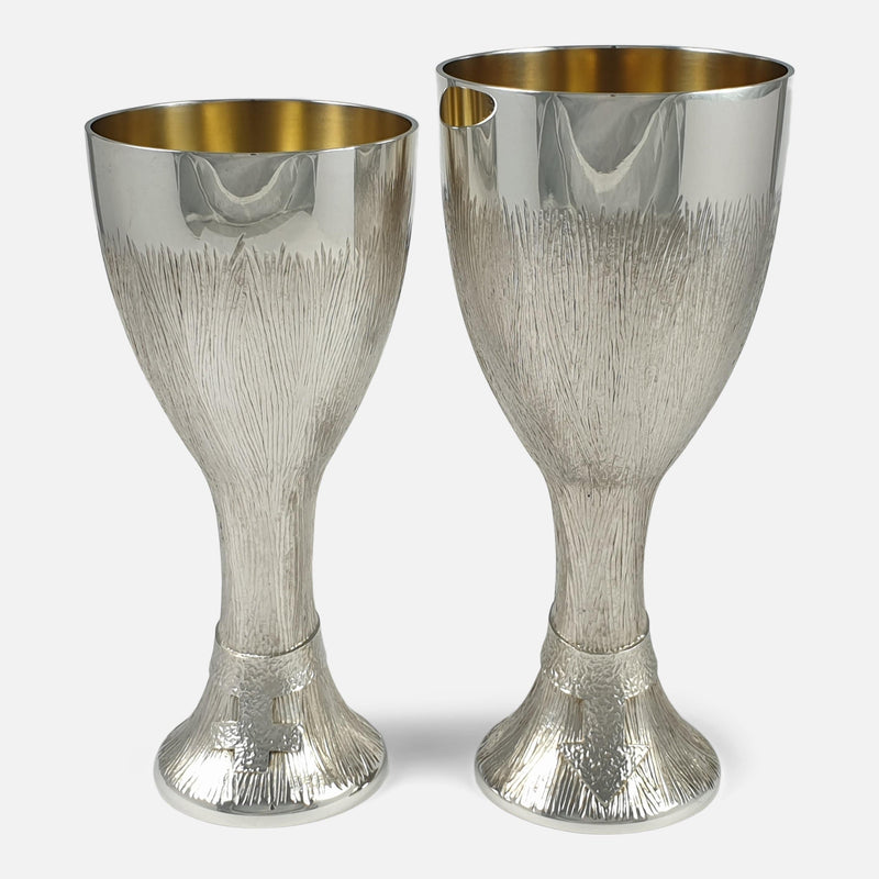 the two sterling silver cups viewed from the front
