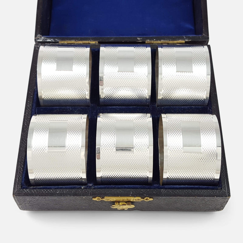Cased Set of 6 Elizabeth II Engine Turned Silver Napkin Rings - Argentum Antiques & Collectables