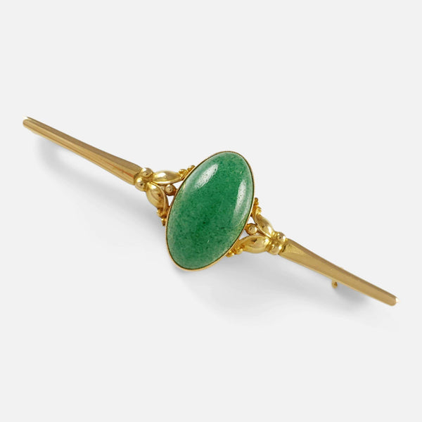 the 18ct gold and aventurine cabochon brooch viewed diagonally