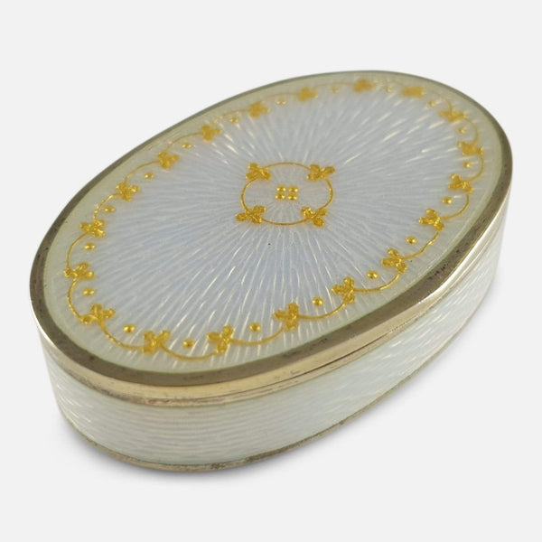 the silver gilt and enamel pill box viewed from a raised position diagonally