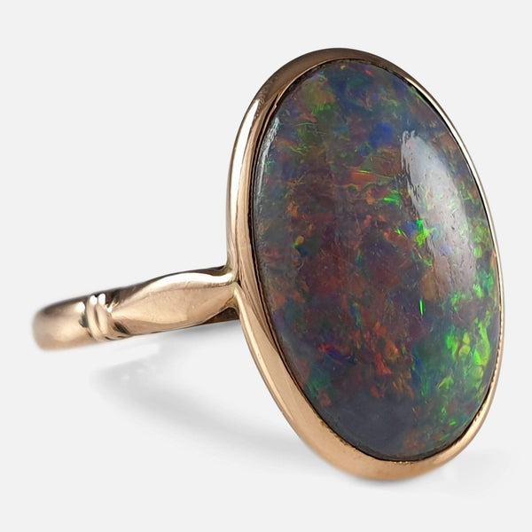 Early 20thC 15ct Rose Gold and Black Opal Cabochon Ring viewed from the left