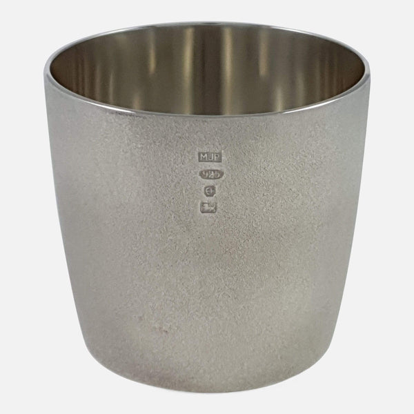 The silver beaker viewed from the front to include Birmingham hallmarks